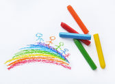 Crayons and kids drawing on white background — Stock Photo