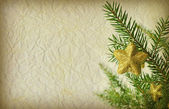 Grunge Christmas background with christmas tree branch — Stock Photo