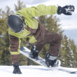 Stock Photo: Snowboarder feint before descending mountain at ski resort of Bansko in Bulgaria