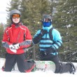 Stock Photo: Two snowboarders before descending mountain at ski resort of Bansko in Bulgaria