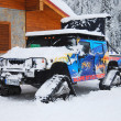 Stock Photo: SUV-snowmobile near sidewalk cafe in ski resort of Bansko in Bulgaria