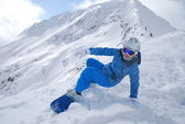 Snowboarder on the mountain in the Bulgarian Bansko on a clear sunny day — Stock Photo