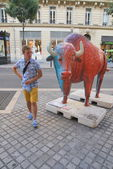 Young man while walking on Gordo Marseille and symbol of the city - Bull — Stok fotoğraf