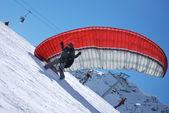 Paragliding dispersed on top of the mountain Todorka Bansko ski resort in Bulgaria — Stock Photo