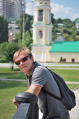 Young man with iPad during a tour of the city of Voronezh — Stock Photo