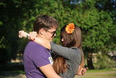 Young man and woman on a walk in the park — Stock Photo