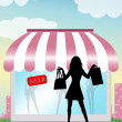 Showcase with woman doing shopping — Stockfoto