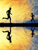 Running at sunset — Stock Photo