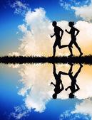 Running couple at sunset — Stock Photo