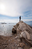 Man on the rock at sea — Stock Photo