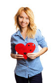Attractive blonde girl holding red heart-shape — Stock Photo
