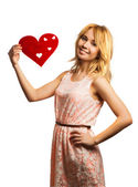 Blonde girle holding red heart-shape — Stock Photo