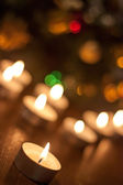 Candles burning near the Christmas tree — Stock Photo