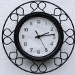 Black clock with white dial — Stock Photo