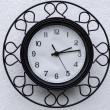 Black clock with white dial — Stock Photo #31644927