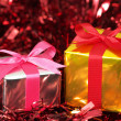Small gifts on red tinsel. — Stok fotoğraf