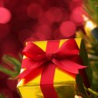 Closeup of small gift on Christmas tree.(vertical) — Stock fotografie