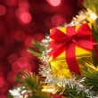 Small gift on Christmas tree.(horizontal) — Stock fotografie