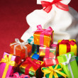Pile of Christmas gifts and white bag. — Stock Photo