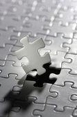 Illuminated puzzle piece.(vertical) — Stock Photo