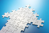 Arrow shaped jigsaw puzzle. — Stock Photo