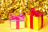 Small gifts on yellow background. — Foto de Stock