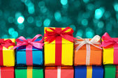 Lining up colorful gifts. — Stock Photo