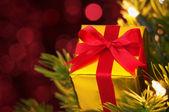 Closeup of small gift on Christmas tree.(horizontal) — Stock Photo