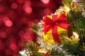 Small gift on Christmas tree.(horizontal) — Stock Photo