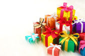 Pile of gifts on white fake fur background. (horizontal) — Foto de Stock