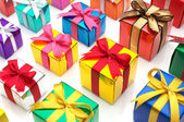 Colorful gifts lined up. — Stock Photo