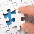 A person fitting the last puzzle piece. — Stock Photo