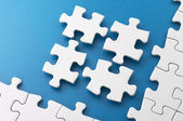 Fitting four puzzle pieces. — Stock Photo