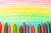 Colorful crayons and drawing of the rainbow. — Stock Photo