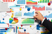 Businessman choosing from a variety of graphs. — Stock Photo