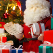 Santa Claus preparing Christmas presents. (vertical) — Stock Photo