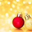 Christmas balls on golden defocused lights background. — Stock Photo