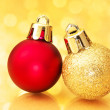 Close up of Christmas balls on gold sparkle background. — Stock Photo #34845443