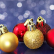 Small Christmas balls on sparkle background. — Stock Photo
