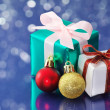 Small presents on blue sparkle background. — Stock Photo