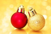 Close up of Christmas balls on gold sparkle background. — Stock Photo