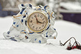 A porcelain table clock — Stock Photo