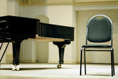Grand piano and chair — Stock Photo