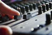 DJ hand over a mixer — Stock Photo