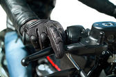 Hand of motorcyclist — Stock Photo