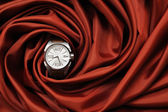 A Wrist Watch on a red Cloth — Stock Photo