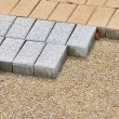 Sidewalk blocks on sand — Stock Photo #32259479