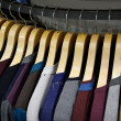 Clothes hangers in a line — Stock Photo