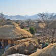 Thatched roof house in Korean Traditional old town called NakAn in Korea — Stock Photo