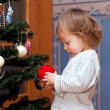 The little boy  with a Christmas tree - Stock Photo